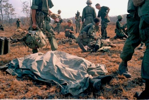 FILE - In this April 2, 1967 file photo shot by Associated Press photographer Horst Faas, a dead U.S. soldier lays on the battlefield with a sheet over him in Vietnam. Faas, a prize-winning combat photographer who carved out new standards for covering war with a camera and became one of the world's legendary photojournalists in nearly half a century with The Associated Press, Thursday May 10, 2012. He was 79. (AP Photo/Horst Faas)